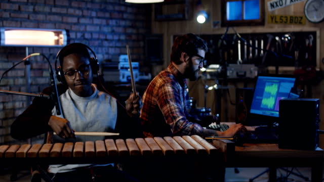 Young musicians playing in home studio