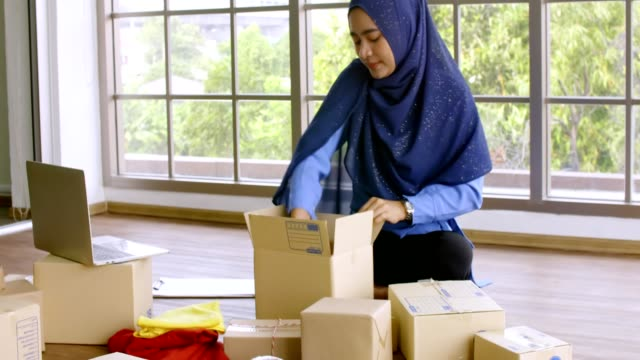 Young Muslim woman with start up small business entrepreneur freelance working at home - video