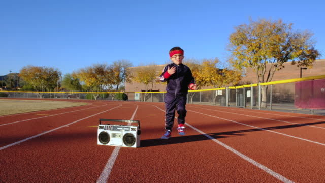 Young Nerd Boy at Track Warming Up