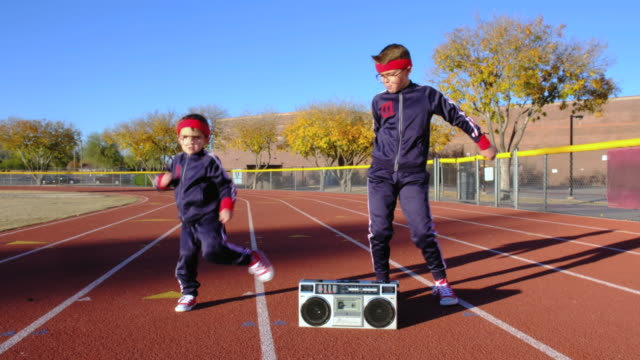 Young Nerd Boys at Track Hip-Hop Dancing