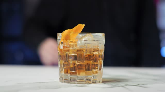 Young novice bartender trainee preparing a cocktail Careless guy Old fashion Whiskey scotch brandy Young novice bartender trainee preparing a cocktail. Careless guy. Old fashion. Whiskey, scotch, brandy. bartender stock videos & royalty-free footage