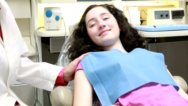 young patient gives thumbs up to camera video