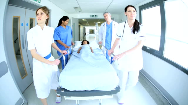 Young Patient Taken by Bed Hospital Ward video
