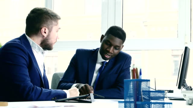 Young people are messy discuss something. One of the businessmen - African American video