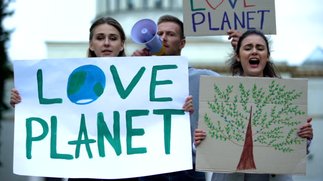 young people chanting slogans about planet ecology, deforestation problems - clima video stock e b–roll