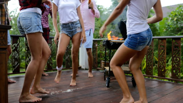 Young People Dancing While Cooking Barbecue Frineds Group Gathering On Summer Terrace Having Party Legs Closeup View Young People Dancing While Cooking Barbecue Frineds Group Gathering On Summer Terrace Having Party Legs Closeup View Slow Motion 60 roast dinner stock videos & royalty-free footage