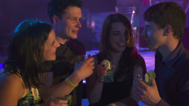 HD: Young People Drinking At Night Bar video