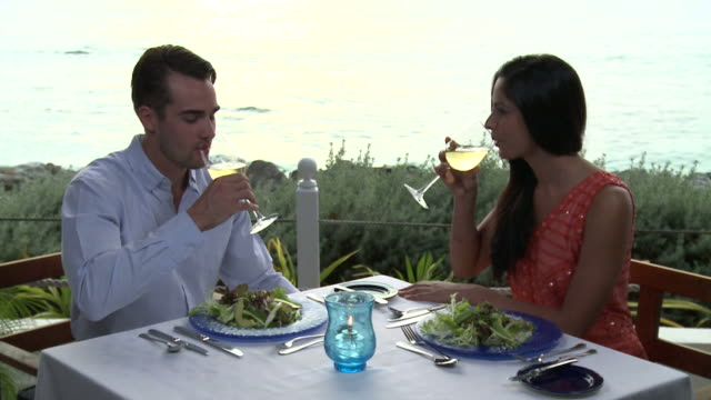 Young people eating dinner video