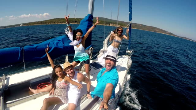 Young people making selfie on yacht - video