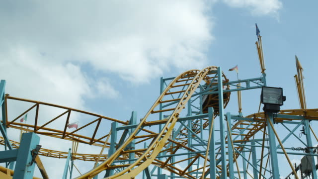young people on rollercoaster - roller coaster stock videos & royalty-free footage