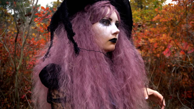 young pink hair witch found rare reagent in the mystical autumn forest. halloween preparation. - gothic fashion stock videos and b-roll footage