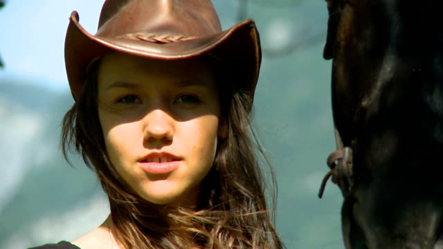 HD: Young pretty cowgirl in nature video