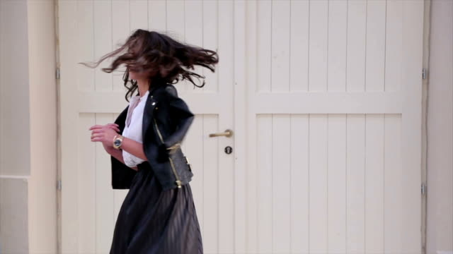 Young pretty fashioned girl turns around. video