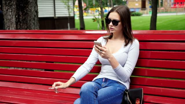 Young pretty girl smoking cigarette video