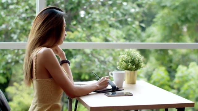 Young pretty woman take a break at coffee shop