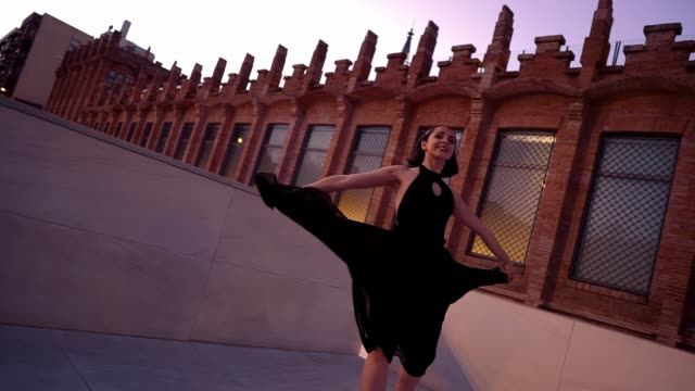 young professional ballerina in black dress is dancing outdoors - tutù video stock e b–roll