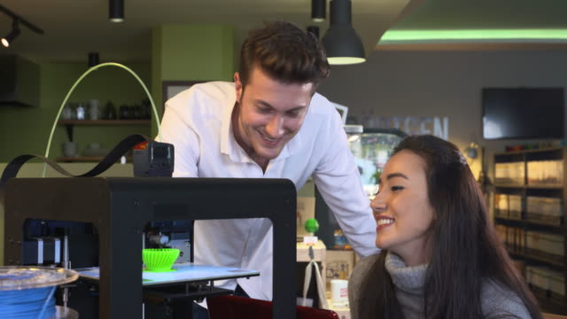 4K: Young professionals working with a 3D printer video