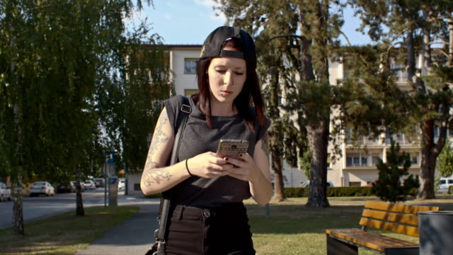 Young punk woman using a phone video