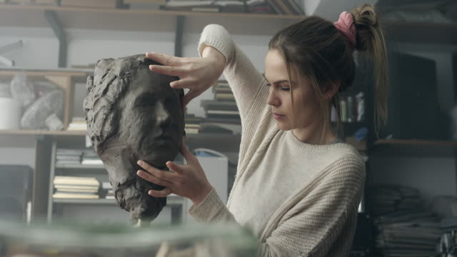 Young sculptor creates a clay sculpture video