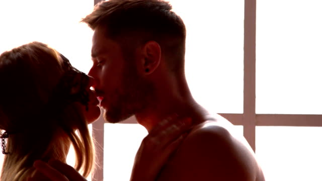 young sensual couple kissing. - heterosexual couple stock videos and b-roll footage