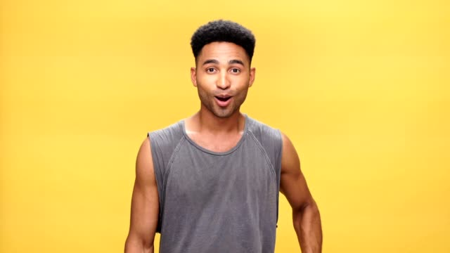 Young shocked african man over yellow background.Young shocked african man over yellow background. video