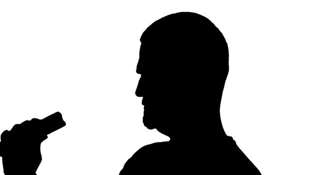 young silhouette man is playing a electric torch black and white isolated studio shot. brightly lit stock videos & royalty-free footage