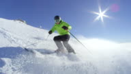 istock SLOW MOTION Young skier stop and smile while sprays snow in camera at ski resort 859860400