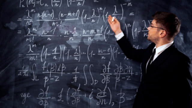 Young smart male teacher or student explaining decision of hard math equation video
