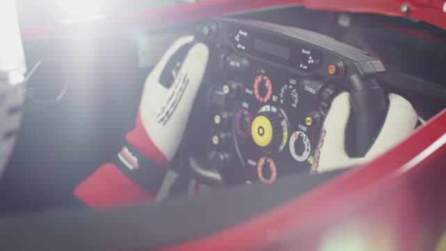 young sportsperson holding steering wheel in car - race stock videos & royalty-free footage