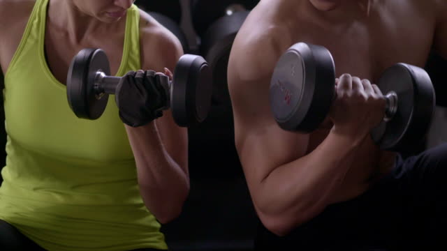 Young sporty couple at gym