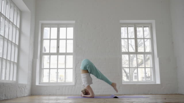young sporty woman doing ashtanga yoga video