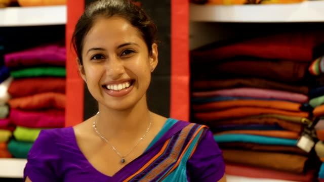 Young Sri Lanka woman in a Sari shop Young Sri Lankan Indian woman as a shop assistant at a Sari shop sri lanka stock videos & royalty-free footage