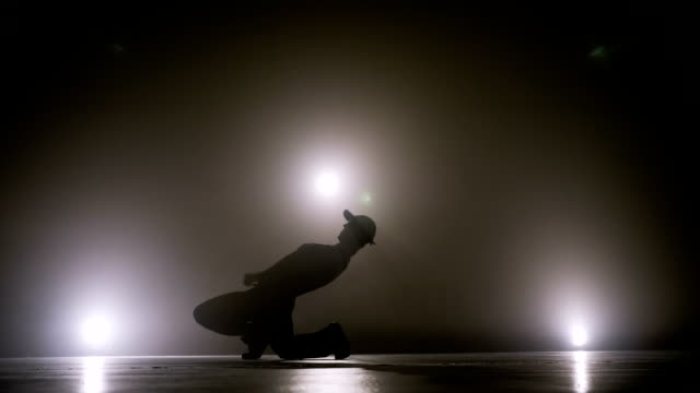 young street dancer boy dancing on a talent show competition stage to become popular - adulazione video stock e b–roll