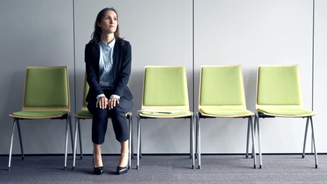 Young stressful woman waiting for job interview Young stressful woman waiting for job interview anticipation stock videos & royalty-free footage