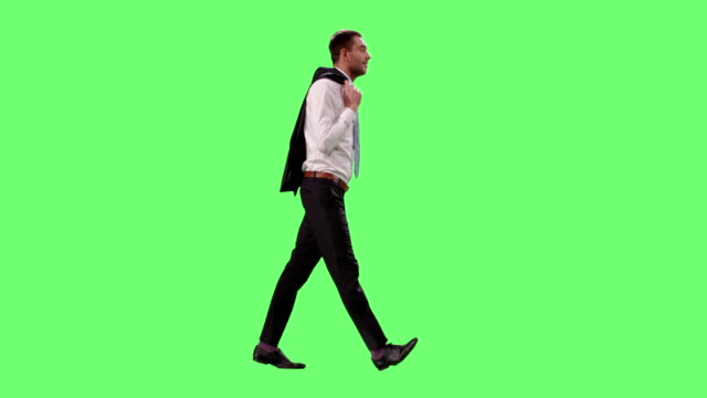Young Successful Businessman in a Suit Enjoys Good Weather Throws Jacket over the Shoulder While Walking. Shot on Mock-up Green Screen. video