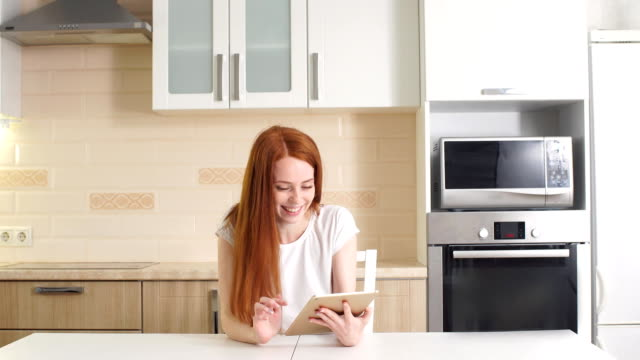 young successful businesswoman using tablet at home living room home office, professional female employer receiving good news excited happy cheerful smiling. success and achievement concept - ape operaia video stock e b–roll
