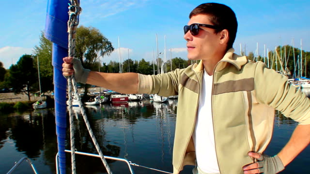 Young successful man on luxury yacht, leader, boss, millionaire video