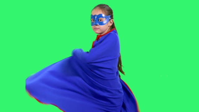 Young superhero girl wraps cloak around her Young superhero girl wraps cloak around her cape garment stock videos & royalty-free footage