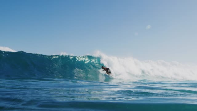 Young surfer ripping in gnarly waves Surfer riding and turning with spray on blue ocean wave, surfing ocean lifestyle, extreme sports, slow motion giant fictional character stock videos & royalty-free footage