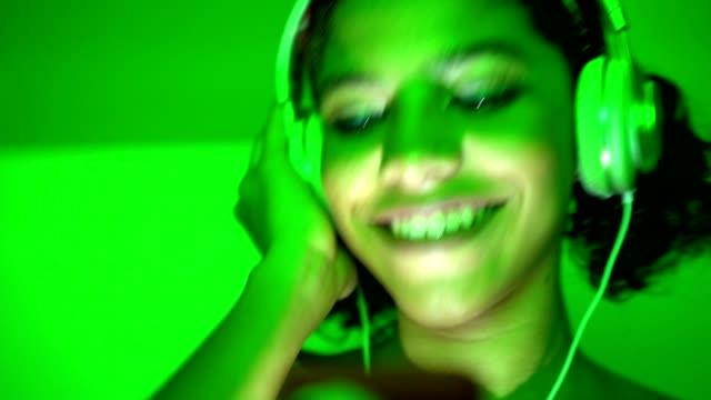 Young teenager dancing in disco