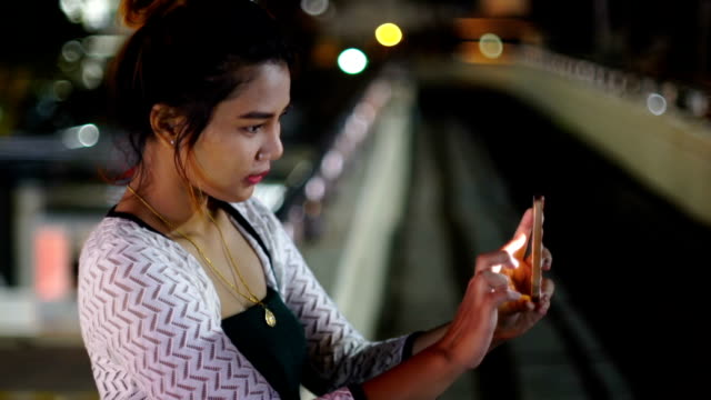 Young Thai Lady making selfie in night city video