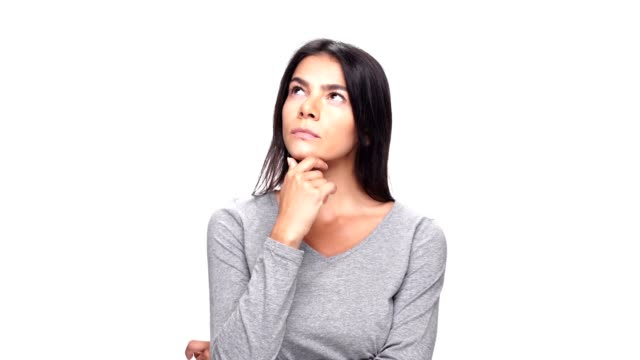 Young thinking caucasian lady have an idea over white background. video