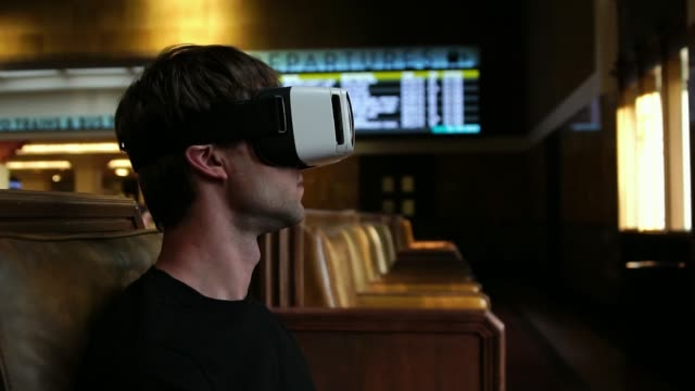 Young tourist man using VR headset for travel entertainment at the airport video