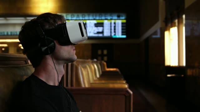 Young tourist man using VR headset Virtual Reality Glasses for travel entertainment video