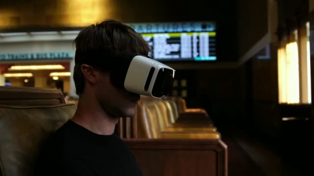 Young tourist man wearing VR headset Virtual Reality Glasses for travel entertainment video
