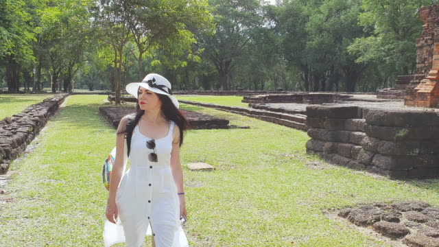 Young tourist woman walking around and enjoying the view of old ancient history architecture