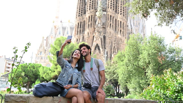Young tourists taking selfie at Sagrada Familia in Barcelona