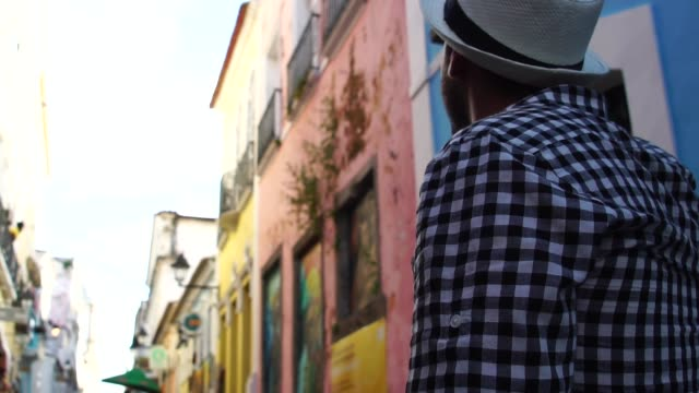 Young traveler walking and looking forward at Pelourinho, Salvador, Brazil video