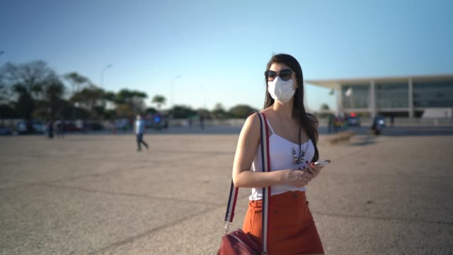 Young traveller woman walking in Brazil - wearing face mask