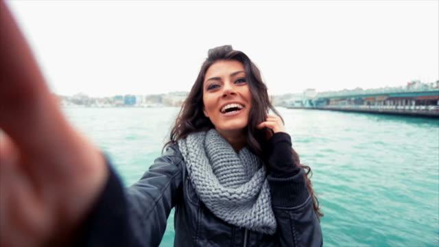 Young Turkish Girl Taking Selfies Near Galata Bridge video